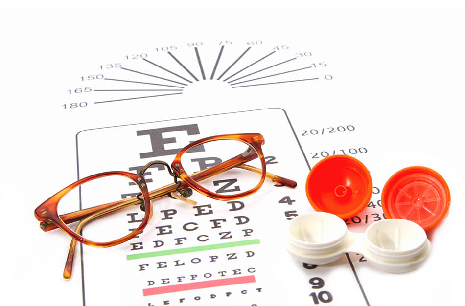 Contact lenses and eye glasses on eye-chart