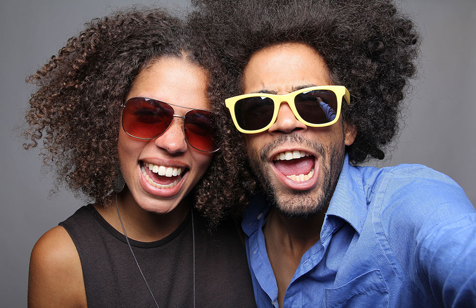 smiling man and woman wearing contact lenses and sunglasses