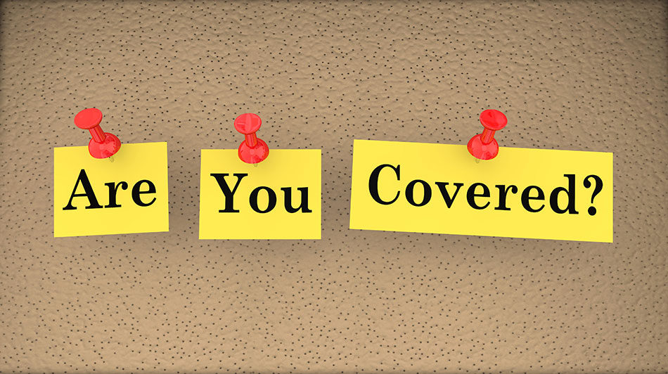 "Corkboard that says ""Are You Covered"" in sticky notes."