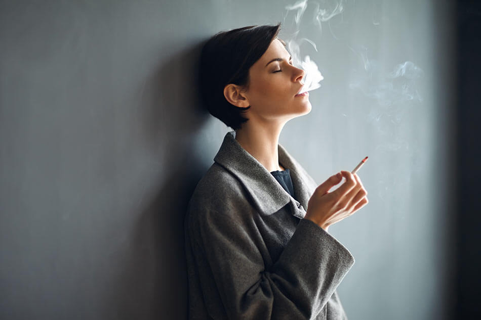 Woman wearing contact lenses and smoking