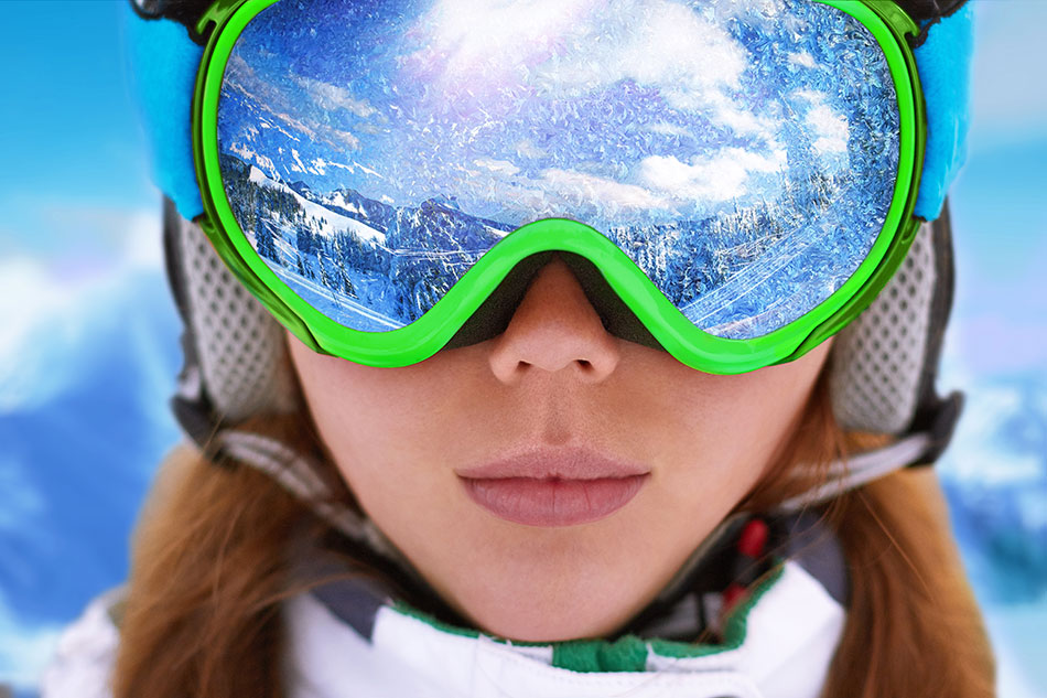 woman wearing snow goggles